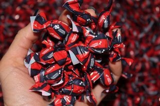 Candies with Admiral Markets logo